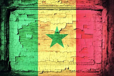 Senegal flag on the old wooden background  photo