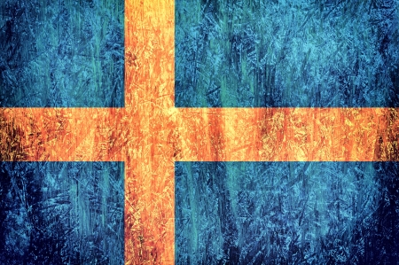 Abstract Swedish flago on the wooden background  photo