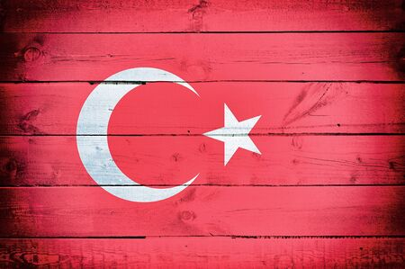 the world expo: Official flag of Turkey on the wooden background