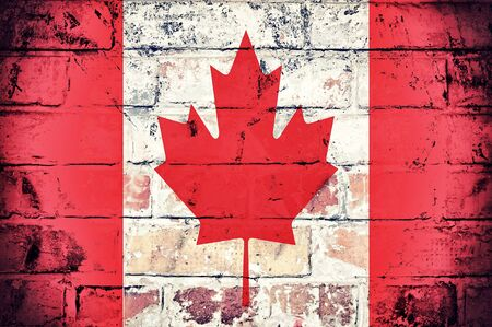 Grunge flag of Canada on the old wall Stock Photo - 21316098
