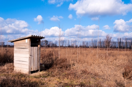 latrine: Small wooden toilet in rural aerial