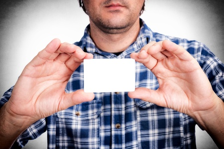 Man holding blank calling card in his hands Stock Photo - 21305509