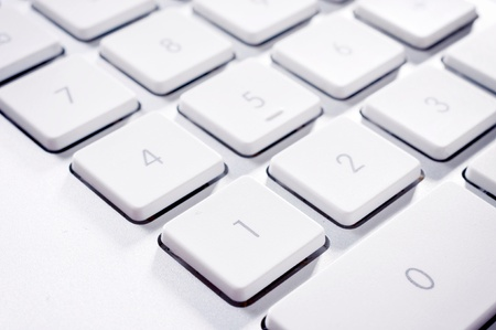numerator: Selective focus on the number one on keyboard