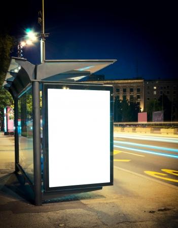 ブランクの看板と夜バス停 写真素材
