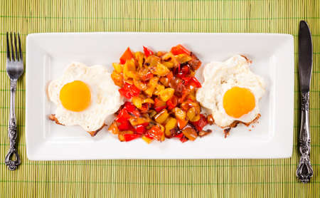 set up: Set up with fried eggs and sliced peppers from above