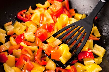 Fresh sliced peppers in the pan with olive oil Stock Photo - 21647783