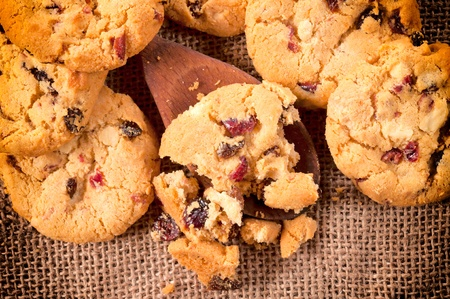 Selective focus on the homemade cookies on wooden ladle  photo