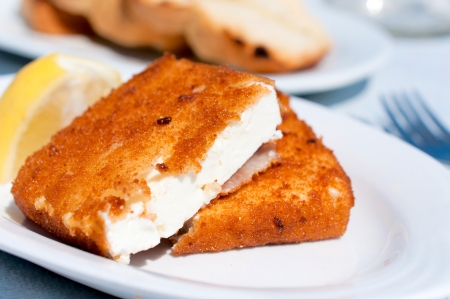 Fried feta cheese on white plate photo