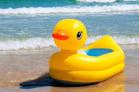 Yellow duck boat at the beach photo