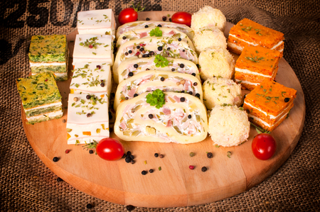 suppertime: Group of the appetizers on wooden board