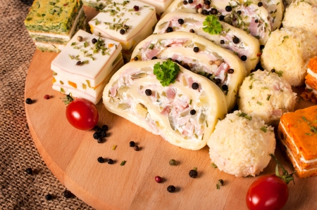 suppertime: Group of food on the wooden board in low key  Stock Photo