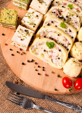 suppertime: Large group of the appetizers on wooden board from above