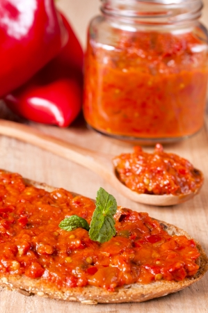Selective focus on the ajvar on whole grain bread