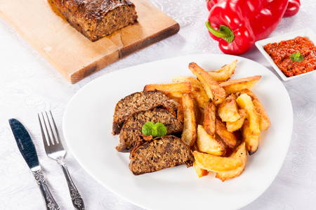 serbian: Traditional Serbian lamb meat with fried potato in the plate