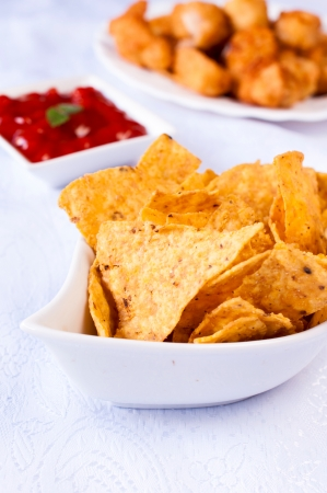 whote: Selective focus on the front tortilla chips in whote bowl