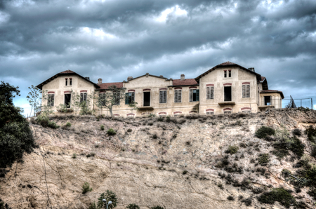 godforsaken: Old and abandoned house on the hill in hdr Stock Photo