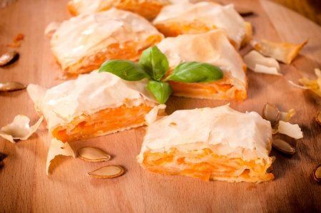 Traditional Serbian pumpkin pie. Selective focus on the front slice of pie Stock Photo - 23208586