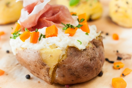 Stuffed potatoe with cheese cream and prosciutto photo
