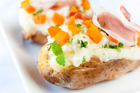 Tasty potato stuffed with cheese cream and prosciutto  photo