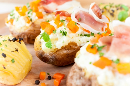 bacon bits: Selective focus on stuffed potato in the middle Stock Photo