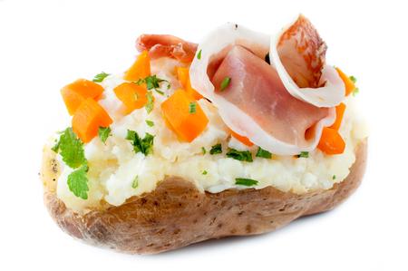 bacon bits: Stuffed potato isolated on white background