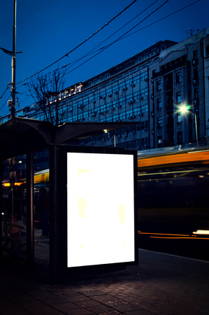Blank billboard on the bus station in long  exposure photo