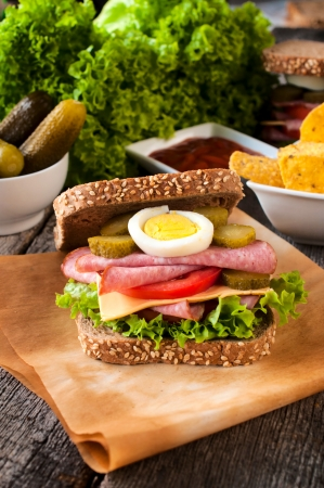 Big tasty toast sandwich with sausage on the table  photo