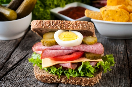 Big toast sandwich with sausage on the wooden table  photo