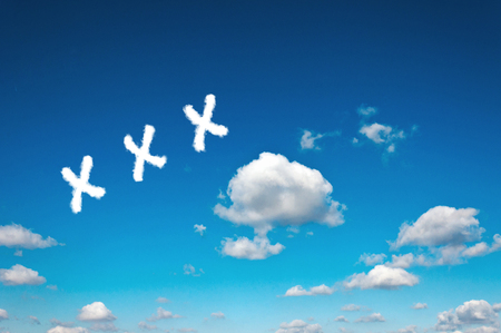 XXX sign clouds on the clear blue sky photo