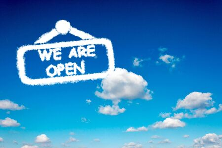 We are open clouds sign on the clear blue sky photo