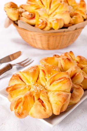 Homemade pastry with ham in the flower shape  photo