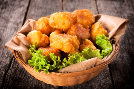 Homemade potato croquettes in the wooden basket  Banco de Imagens