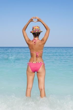 valentine s day beach: Hear shape and female at the beach