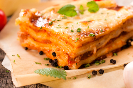 Juicy homemade lasagna with beef meat.Selective focus in the middle of lasagna photo
