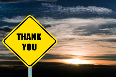 Thank you yellow road sign with clouds and sky  photo