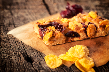 loe: Selective focus on the healthy snack with cranberry and corn flakes  Stock Photo
