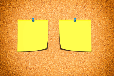 Notes board with two yellow blank papers  photo