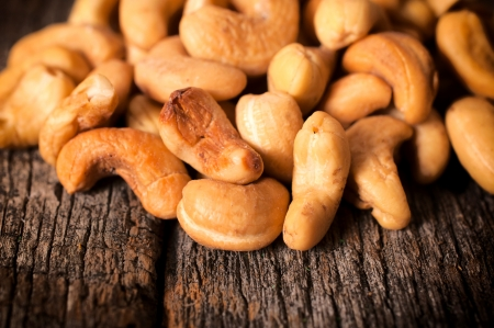 cashew nuts: Close up to cashew nuts on the wooden table