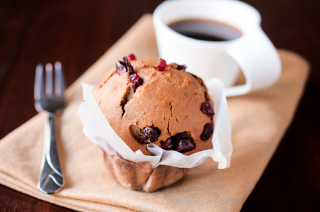 Homemade sponge cake with dried cranberries and cup of coffee. Stock Photo - 24813706