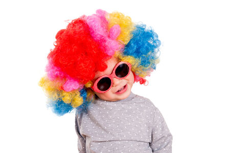 Funny baby with clown wig and sunglasses  photo