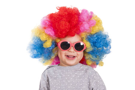 Happy little child wearing clown wig and retro style sunglasses photo