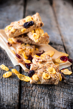 loe: Corn flakes and cranberry cookies.selective focus in the middle of front cookie