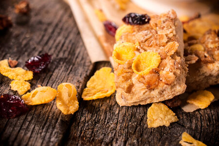 Selective focus on the front cookie with cranberry and corn flakes Stock Photo