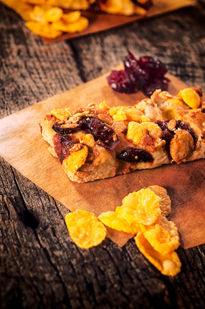 loe: Healthy homemade cookies with dried cranberry and corn flakes.Selective focus on the cookie