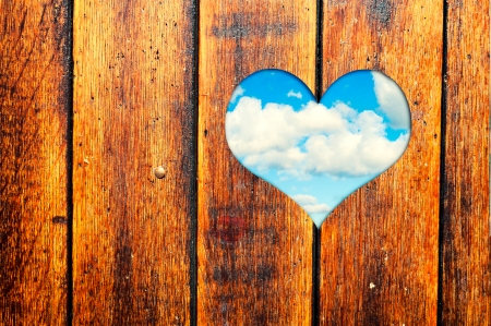 Wooden surface with heart shape window  photo