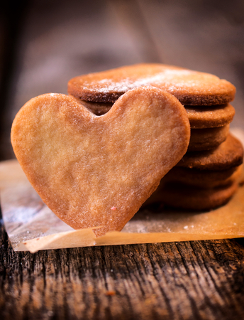 Homemade heart shape cookies on the table.Selective focus in the middle of front cookie photo