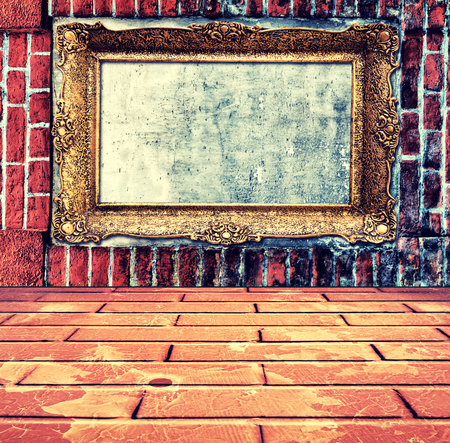 Empty old frame on the bricks wall