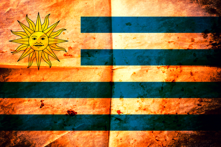 uruguay flag: Old creased paper with Uruguay flag