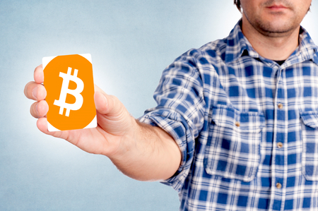 Selective focus on the bitcoin card in mans hand Stock Photo - 25791149