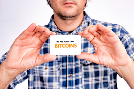 Man holding card with bitcoins accepting sign  Stock Photo - 25791151